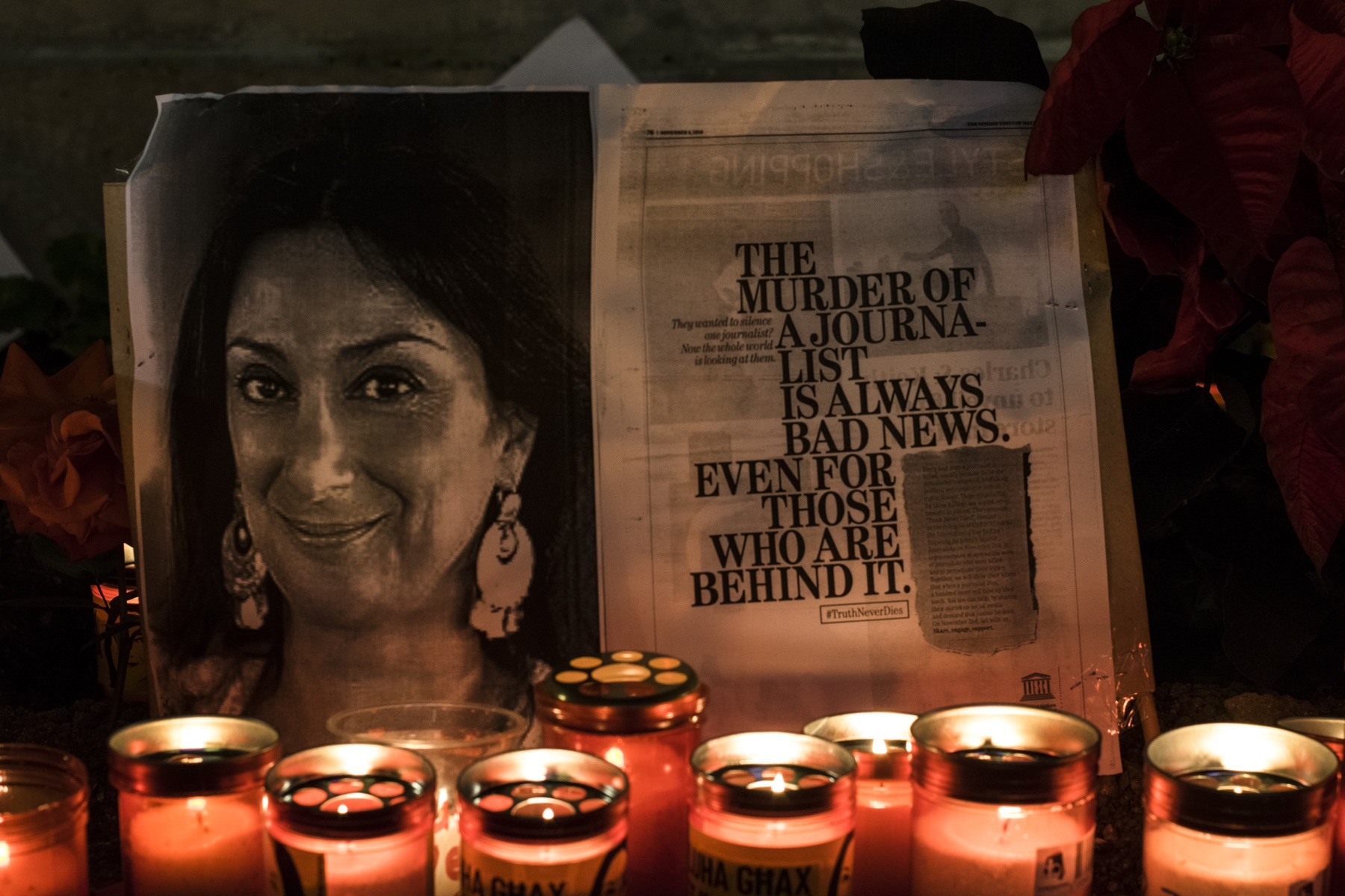 Lit candles placed in front of the protest memorial to Daphne, in Valletta, Malta.
